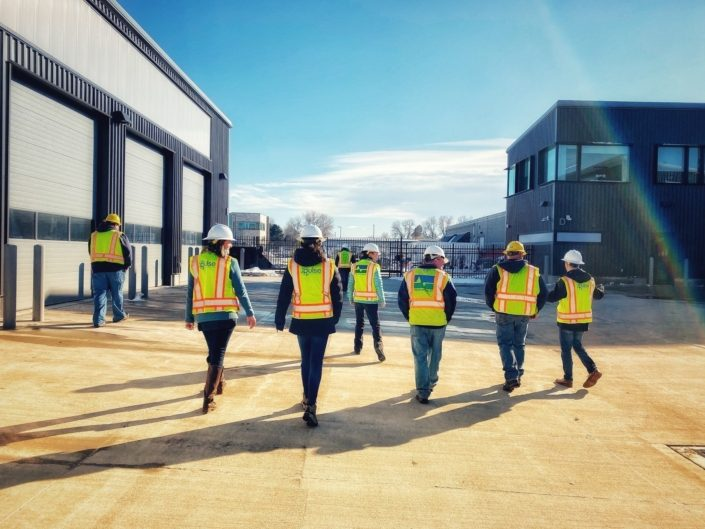Pulse Staff Members In Yellow Construction Vests